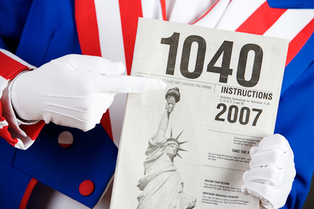 Patriotic Holding Instructions For 1040 Tax Form Stock Photo