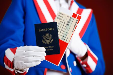 Patriotic: Holding A Passport And Airline Ticket