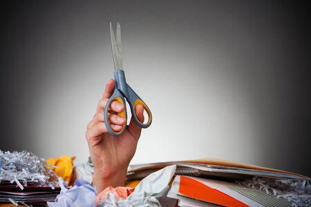 Business: Buried Hand Holding Scissors Zdjęcie Seryjne