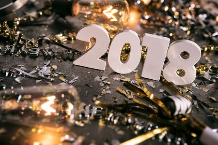 New Year: Standing 2018 Numbers Amidst Party Mess