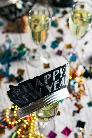 Happy New Year Crown Sits Upon Glass Of Champagne Stock Photo