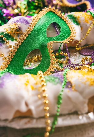 Series for the celebration of Mardi Gras, including Hurricane drinks, a King Cake, masks and trinkets. Stock Photo