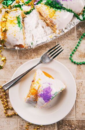 Series for the celebration of Mardi Gras, including Hurricane drinks, a King Cake, masks and trinkets. Stok Fotoğraf