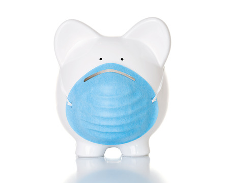 Medical costs of infectious outbreaks illustrated by piggy bank with medical mask.