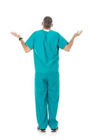 Humorous male doctor in scrubs in a variety of poses on a white isolated background. Rear view of unsure shrugging man.
