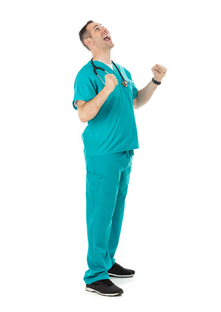 Humorous male doctor in scrubs in a variety of poses on a white isolated background. Man yells upwards with fists raised.