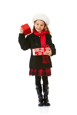 Cute little girl dressed in winter clothing, appropriate for Christmas holiday use.
