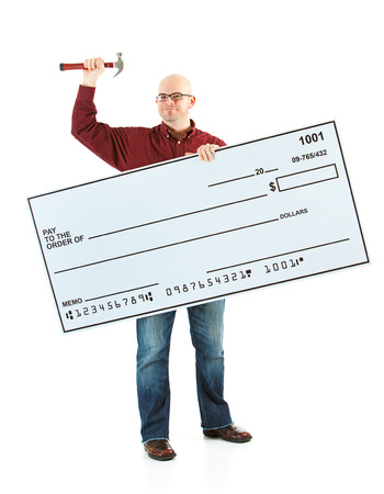 Isolated on white background series of a Caucasian man with an oversized bank check. Foto de archivo