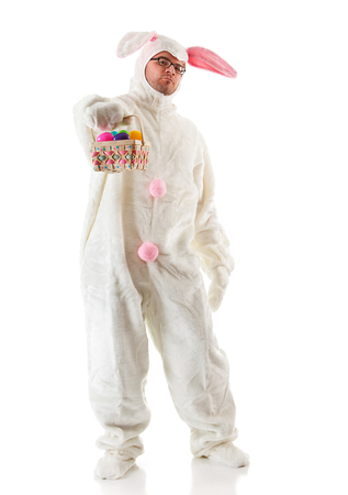 Isolated on white humorous series of a man in a fuzzy bunny suit. Good for Easter or ironic situations.