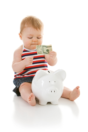 Cute Caucasian baby, isolated on white, with various props. Stock Photo