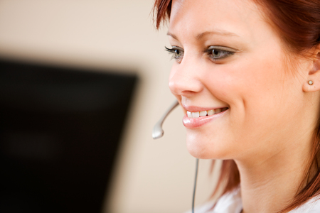 Series with a pretty Customer Service Representative and headset. Stock Photo