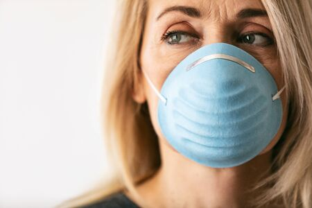 Series on white background and outside, of people wearing medical masks as defense against a virus.