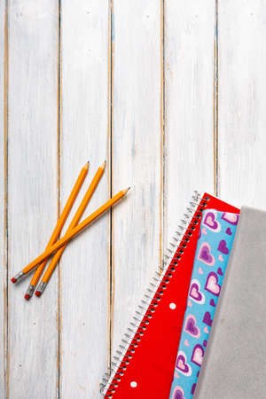 Series on weathered wood background with school items, as well as face masks and hand sanitizer for back to school.