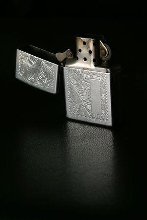 unlit: open unlit silver lighter