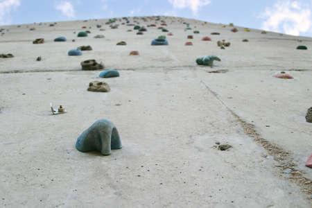 climbing  wall: Climbing wall with grips