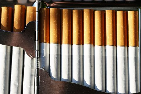 cigarettes in a cigarette case Stock Photo