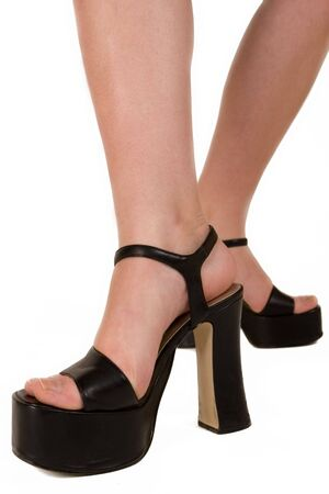Ladies feet in black high sole shoes