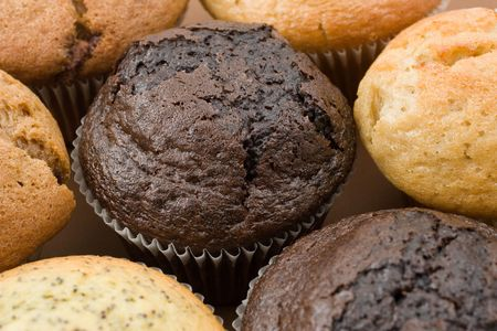 A Plate of muffins - Chocolate muffin in focus