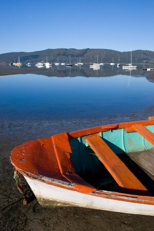 derelict: Derelict boat next to the water - Knysna Harbour, South Africa Stock Photo