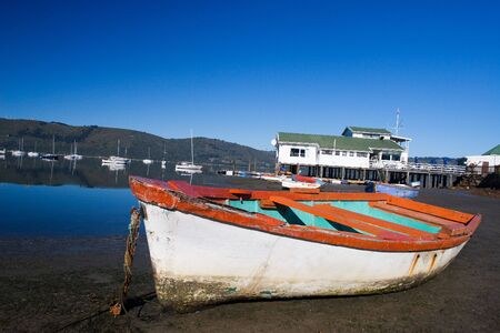 Derelict boat next to the water - Knysna Harbour, South Africa Stock Photo