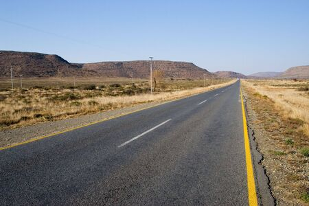 desolate: Desolate road just outside Colesberg, South Africa Stock Photo