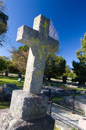 Old stone Grave in the shape of a cross at the Belvedere Church, Knysna, South Africa photo