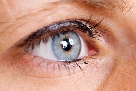 Blue female eye with eyeliner - Shallow Depth of Field Stock Photo