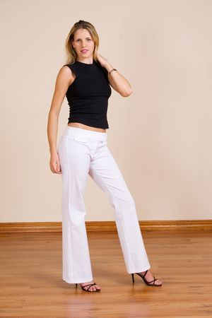 white pants: Beatiful blonde woman with white pants and a black top Stock Photo