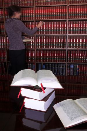 Legal books on table - South African Law Reports - Intern doing research Stock Photo - 232300
