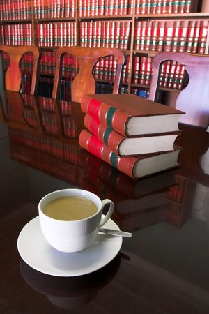 White Coffee cup with Legal Library in background and books on the table Stock Photo - 233183