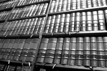 law office: Legal Library in wooden bookcase - South African Law Reports - High Key BW