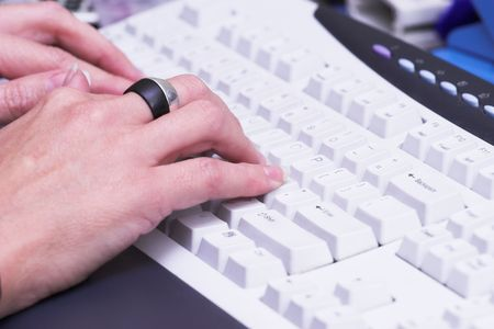 woman typing: Woman typing on office keyboard Stock Photo