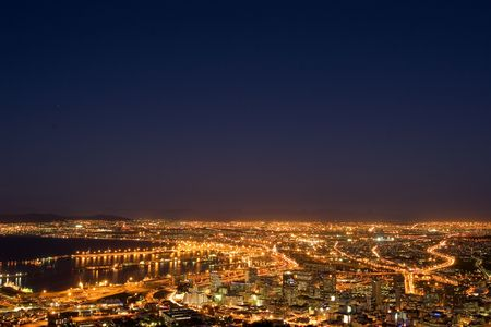 horison: Downtown Cape Town and Harbour at night - South Africa Stock Photo