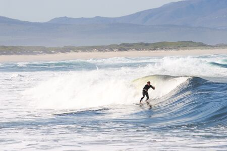 Unknown Surfer on Kleinmond beach - South Africa Stock Photo