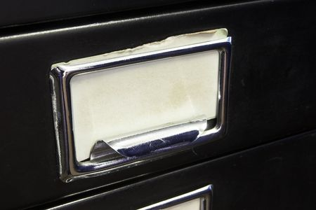 Close-up of a black mini filing cabinet and label photo
