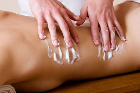acupressure hands: Woman lying on massage table with the hands of male masseuse on her back