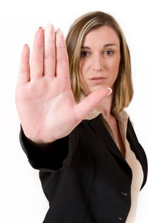 str: Business woman in black suit holing up hand.  Shallow DOF, hand in focus, eyes out of focus Stock Photo