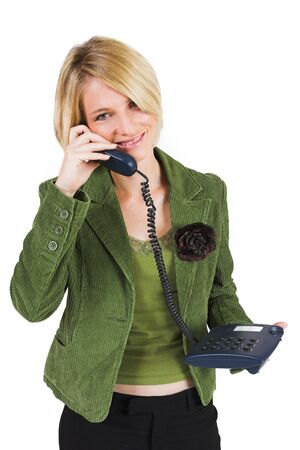Business woman green jacket, talking friendly on the phone photo