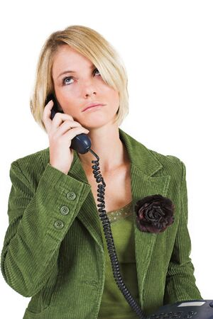 Business woman in green jacket, talking on phone and looking upwards photo