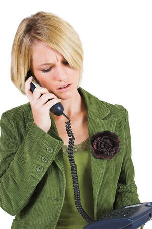 Business woman in green jacket talking on the phone, looking down photo