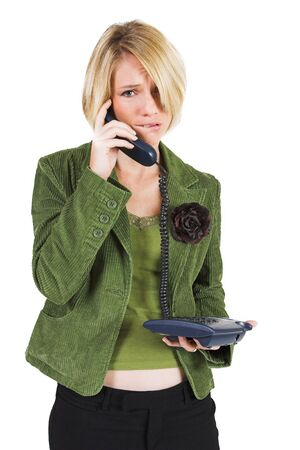 Business woman green jacket, talking  on the phone, looking stressed photo