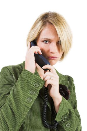 Business woman green jacket, talking seriously on the phone photo