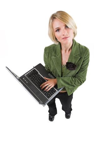 Business woman green jacket, holding laptop, looking up photo