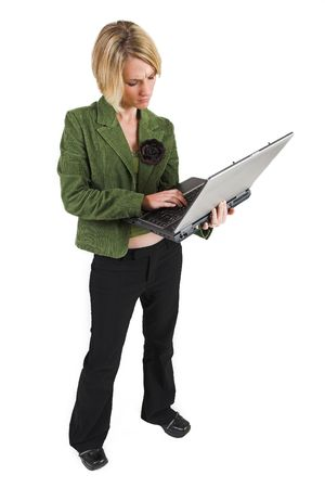Business woman green jacket, holding laptop photo