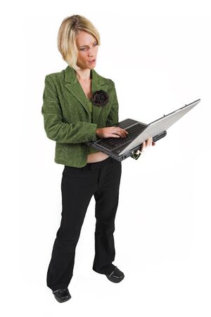 Business woman green jacket, working on laptop photo
