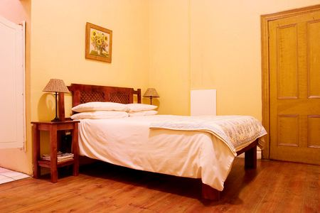 overnight: Interior of room with wooden floors