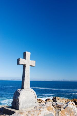 Old stone Grave in the shape of a cross at Gordons Bay,  South Africa photo