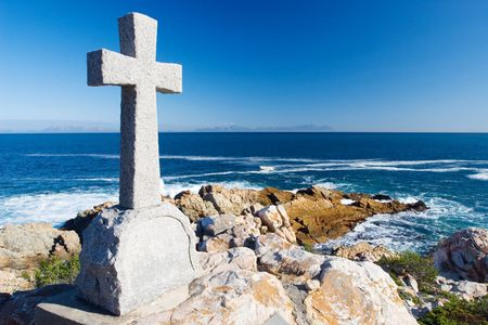 Old stone Grave in the shape of a cross at Gordons Bay,  South Africa Stock Photo