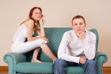 Woman and boyfriend sitting on couch photo