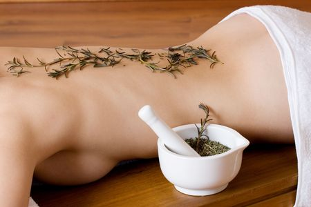 Herbs on back of woman - beauty